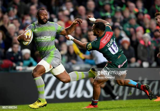 Vereniki Goneva of Newcastle Falcons burstes past Telusa Veainu of Leicester Tigers to score the opening try during the Aviva Premiership match...