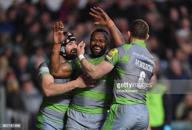 Vereniki Goneva of Newcastle Falcons is congratulated by teammates after scoring a try during the Aviva Premiership match between Leicester Tigers...