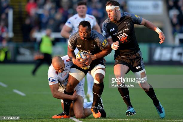 Vereniki Goneva of Newcastle Falcons is tackled by Olly Woodburn of Exeter Chiefs during the Aviva Premiership match between Newcastle Falcons and...