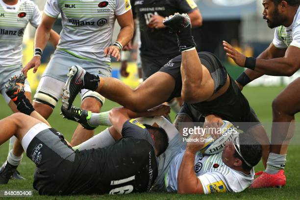 Vereniki Goneva of the Newcastle Falcons tackles Kieran Longbottom of the Saracens during a Aviva Premiership match between the Newcastle Falcons and...
