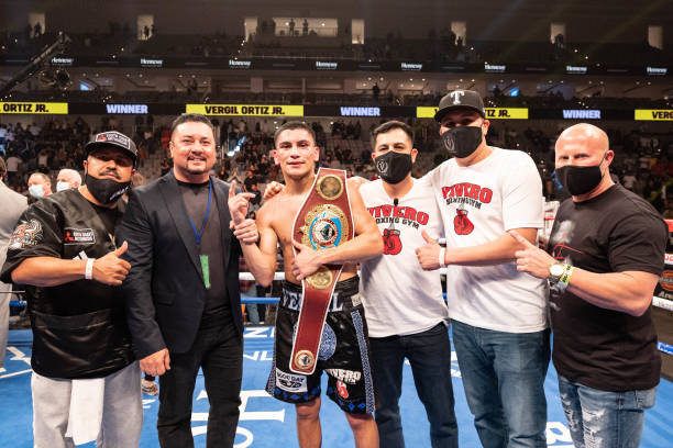 Vergil Ortiz Jr. And his team pose after defeating Maurice Hooker in their WBO international welterweight championship bout at Dickies Arena on March...