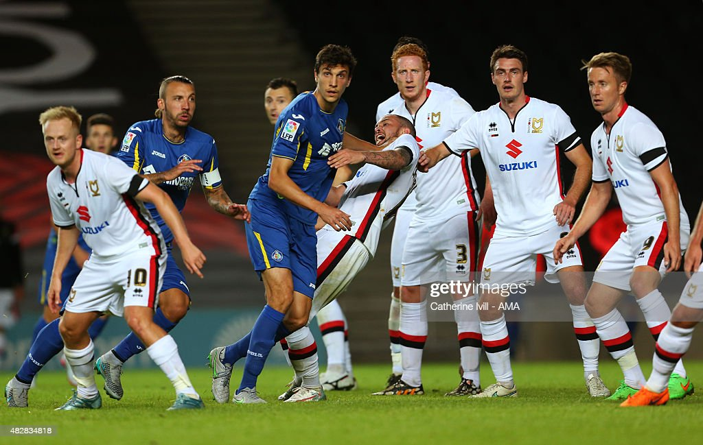 Vergini of Getafe pushes Samir Carruthers during the pre-season friendly between MK Dons and Getafe at Stadium mk on July 28, 2015 in Milton Keynes, England.