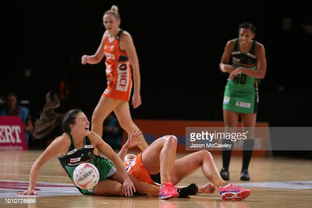 Verity Charles of the Fever collides with Kimberlee Green of the Giants during the round 14 Super Netball match between the Giants and the Fever at...