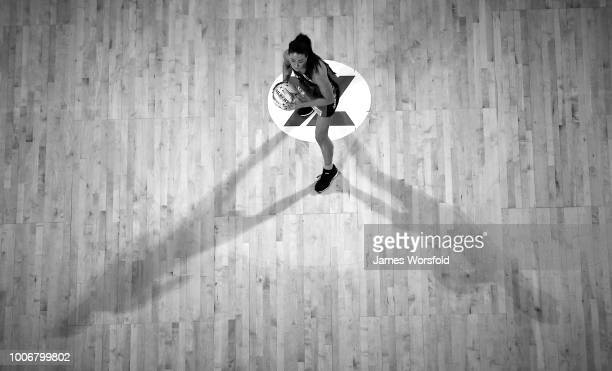 Verity Charles of the West Coast Fever looks to pass in the centre circle during the round 13 Super Netball match between the Fever and the Vixens at...