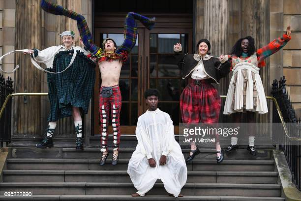 Verity Pease Frank Mullholland Jerome Katende Kasusula Jessica Le and Grace Mark model Sgaire Wood designs as they take part in the lasgow School of...