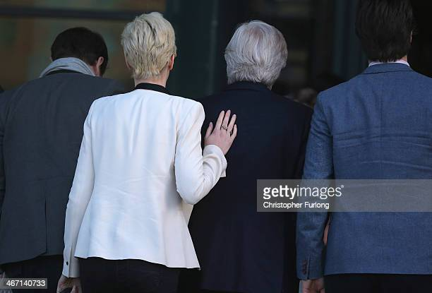Verity Roache places a comforting hand on the back of her father actor William Roache as they arrive at Preston Crown Court where he is facing trial...