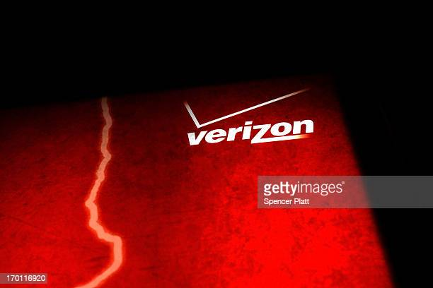 Verizon advertisement is viewed outside of a store on June 7 2013 in New York City In a statement today US President Barack Obama defended the...