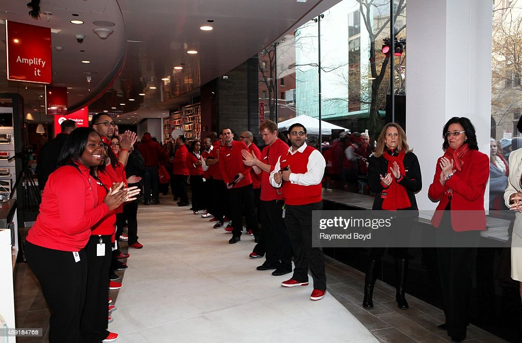 Verizon Wireless store employees prepare to welcome the