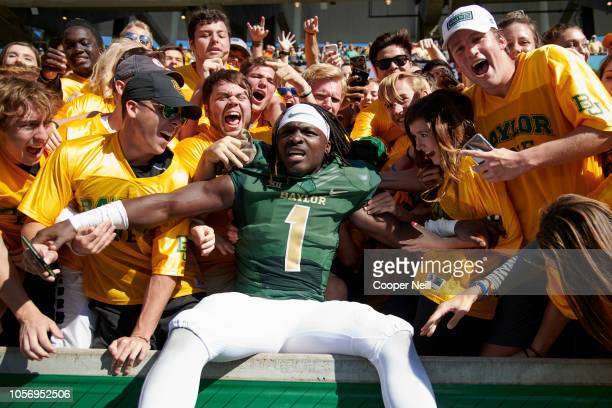 Verkedric Vaughns of the Baylor Bears celebrates with the Baylor Line after defeating the Oklahoma State Cowboys 3531 in an NCAA football game at...