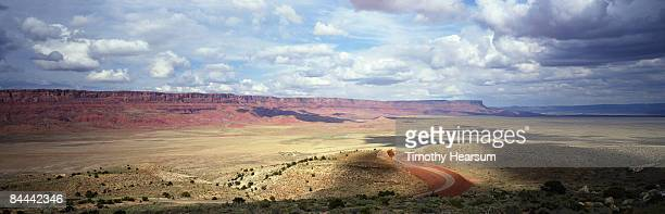 vermillion cliffs with winding road - timothy hearsum stock photos and pictures