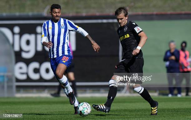 Vermin Zolotic of Casa Pia AC with Igor Cassio of FC Porto B in action during the Liga Pro match between Casa Pia AC and FC Porto B at Estadio Pina...