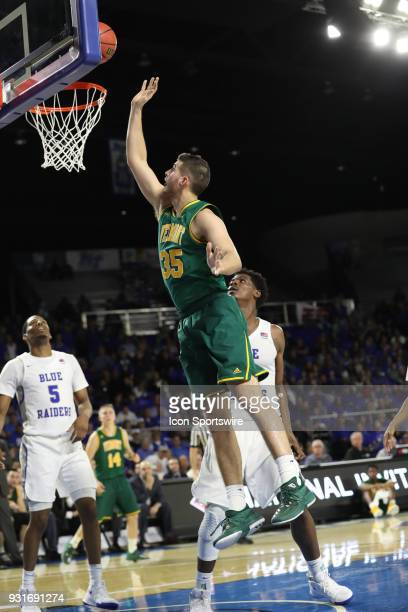 Vermont Catamounts forward Payton Henson shoots a easy lay up during the third quarter of the NIT first round basketball game between the University...