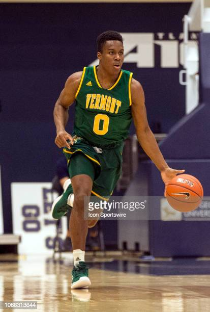 Vermont Catamounts guard Stef Smith dribbles up court during a men's college basketball game between George Washington University and the University...