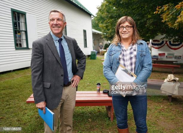 Vermont Governor Phil Scott and Vermont Democratic gubernatorial challenger Christine Hallquist meet prior to holding a debate September 14, 2018 at...