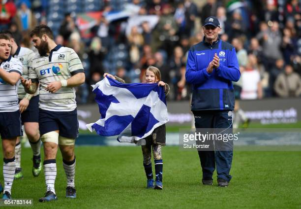 Vern Cotter the head coach of Scotland applauds the fans following his last game in charge during the RBS Six Nations match between Scotland and...