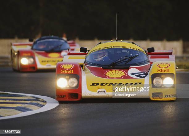 Vern Schuppan of Australia drives the Shell/Dunlop Porsche AG Porsche 962 C ahead of team mate Derek Bell in the during the FIA World Sportscar...