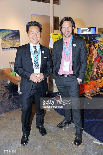 Vern Yip and guest attend The UNICEF Experience at Mason Murer Fine Art Gallery on April 28 2013 in Atlanta Georgia