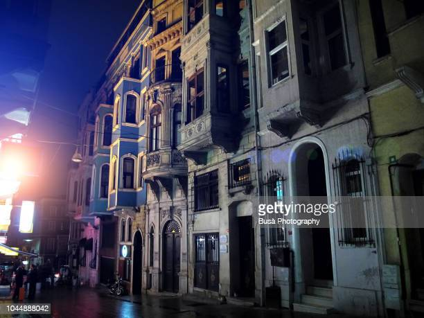 Vernacular architectures in an alley in the historic district of Taksim Beyoglu in Istanbul, at night. Istanbul. Turkey