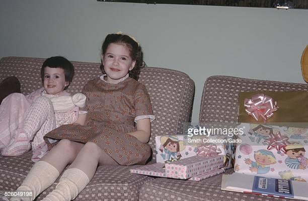 Vernacular snapshot image of sisters smiling, 1963. .
