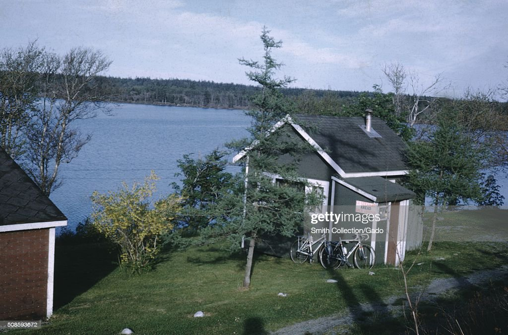 Vernacular snapshot photograph of lake and bicycles, 1966. (Photo by Smith Collection/Gado/Getty Images).