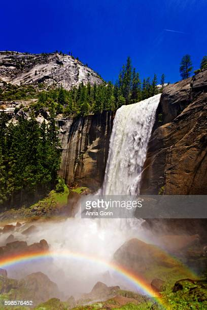 Vernal Fall along Mist Trail at peak flow in early summer with vivid rainbow, Yosemite National Park