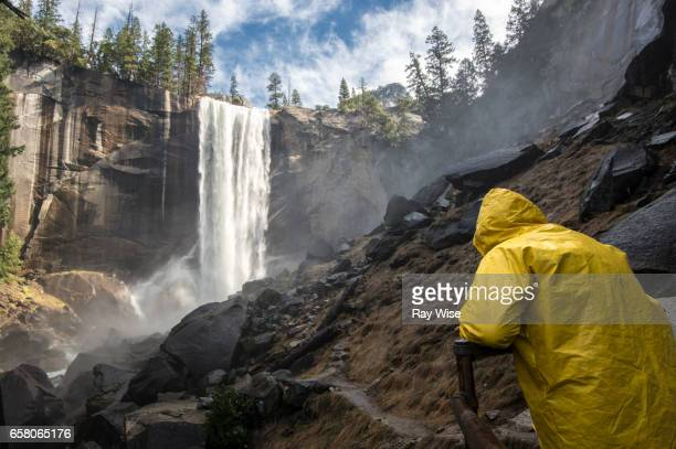 Vernal Falls and person in yellow raincoat