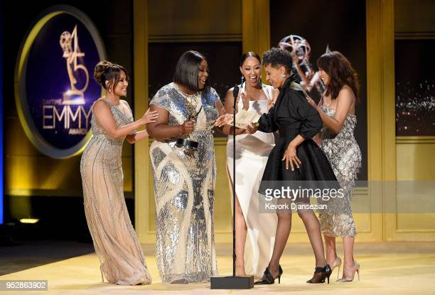 Vernee Watson winner of Outstanding Guest Performer in a Drama Series for 'General Hospital' accepts award from Adrienne Bailon Loni Love Tamera...