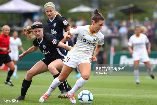 Verónica Boquete of Utah Royals FC dribbles with the ball against Bethany Balcer of Seattle Reign FC in the first half during their game at Cheney...