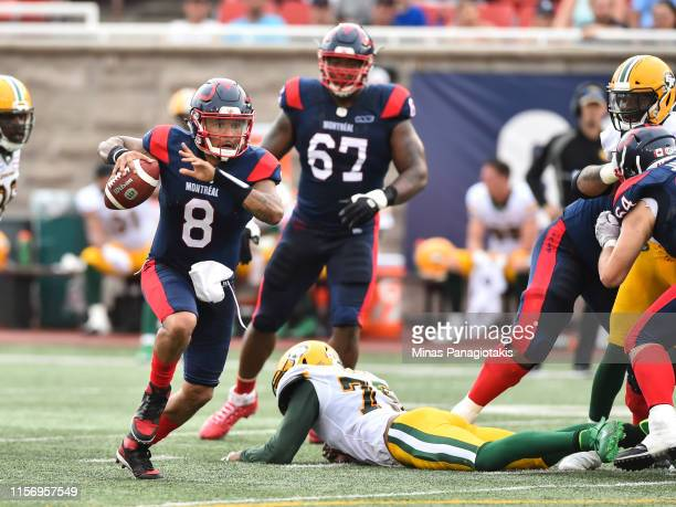 Vernon Adams Jr #8 of the Montreal Alouettes runs the ball against the Edmonton Eskimos during the CFL game at Percival Molson Stadium on July 20...