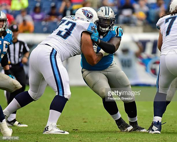 Vernon Butler of the Carolina Panthers is blocked by Jeremiah Poutasi of the Tennessee Titans during the second half at Nissan Stadium on August 20...