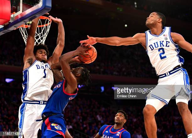 Vernon Carey Jr. #1 and Cassius Stanley of the Duke Blue Devils guard and block Marcus Garrett of the Kansas Jayhawks shot during the second half of...