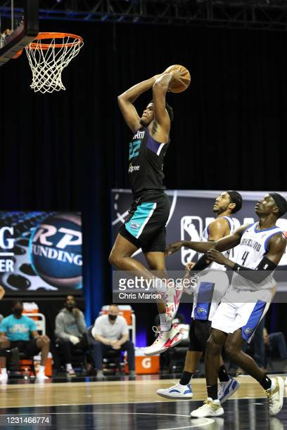 Vernon Carey Jr. #22 of the Greensboro Swarm dunks the ball against the Lakeland Magic on March 1, 2021 at HP Field House in Orlando, Florida. NOTE...