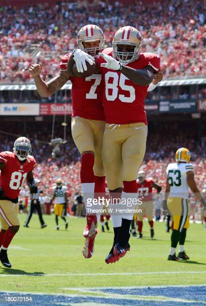 Vernon Davis and Colin Kaepernick of the San Francisco 49ers celebrate after Davis caught a twenty two yard touchddown pass in the first quarter...