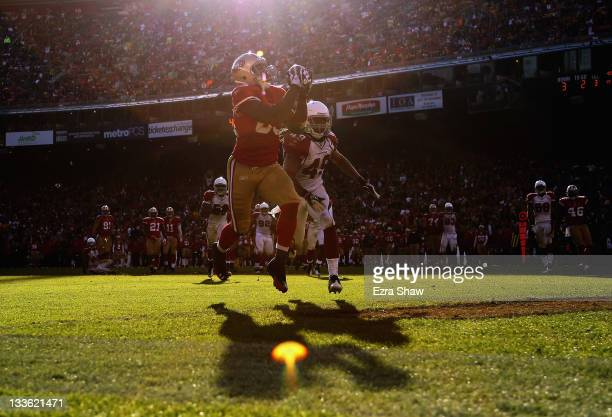 Vernon Davis of the San Francisco 49ers catches a touchdown pass in front of Rashad Johnson of the Arizona Cardinals at Candlestick Park on November...