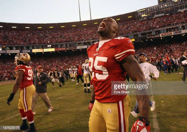 Vernon Davis of the San Francisco 49ers celebrates after they beat the New Orleans Saints in the NFC Divisional playoff game at Candlestick Park on...