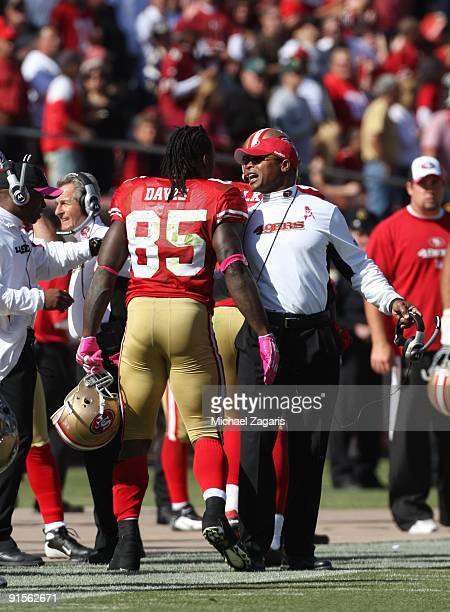 Vernon Davis of the San Francisco 49ers is congratulated by head coach Mike Singletary during the NFL game against the St Louis Rams at Candlestick...