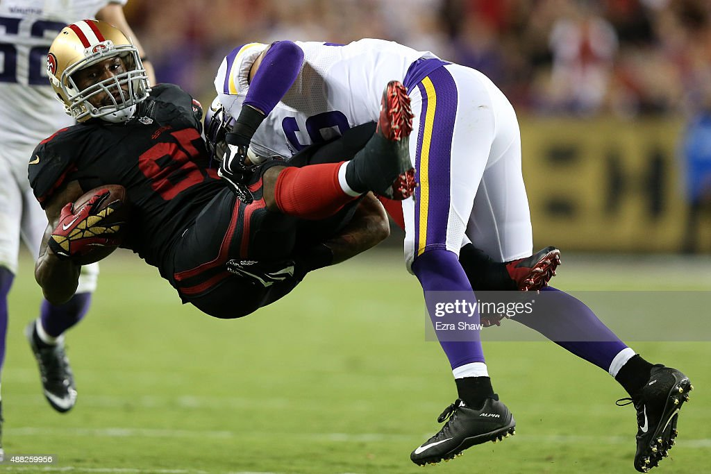 Vernon Davis #85 of the San Francisco 49ers is tackled by Robert Blanton #36 of the Minnesota Vikings after a catch during their NFL game at Levi's Stadium on September 14, 2015 in Santa Clara, California.