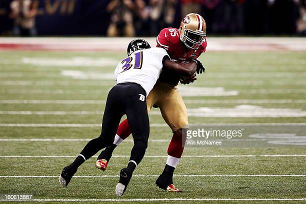 Vernon Davis of the San Francisco 49ers makes a reception in the first quarter against Bernard Pollard of the Baltimore Ravens during Super Bowl...