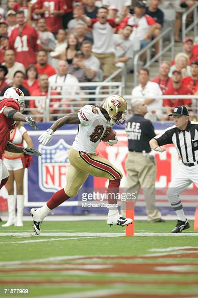 Vernon Davis of the San Francisco 49ers scores a touchdown during the season opening game against the Arizona Cardinals at Cardinals Stadium on...