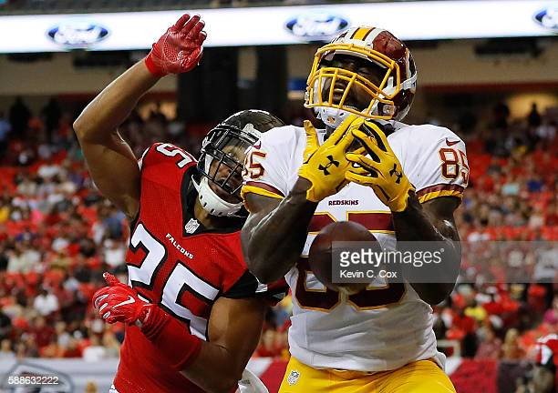 Vernon Davis of the Washington Redskins fails to pull in this touchdown reception against Akeem King of the Atlanta Falcons at Georgia Dome on August...