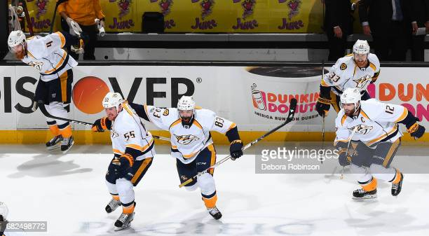 Vernon Fiddler and Cody McLeod of the Nashville Predators celebrate their 32 overtime win with their teammates in Game One of the Western Conference...