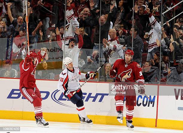 Vernon Fiddler and Keith Yandle of the Phoenix Coyotes celebrate after a goal against the Washington Capitals on February 14 2011 at Jobingcom Arena...