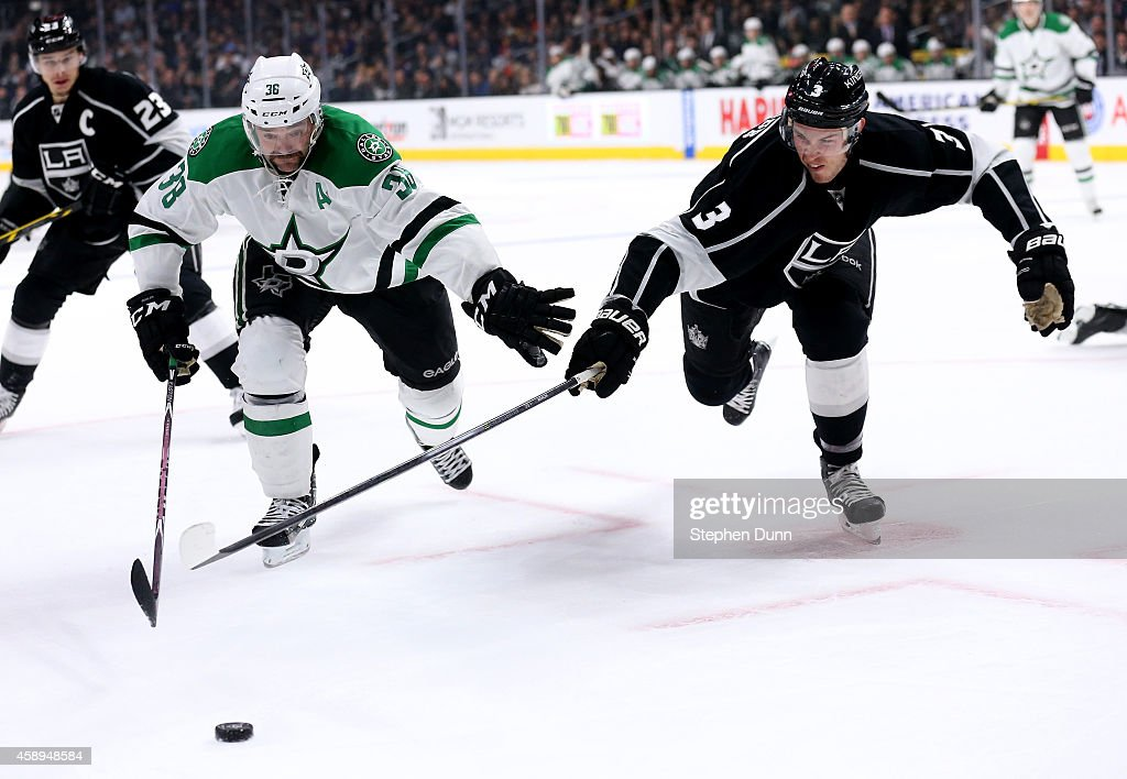Vernon Fiddler #38 of the Dallas Stars and Brayden McNabb #3 of the Los Angeles Kings race for the puck at Staples Center on November 13, 2014 in Los Angeles, California.