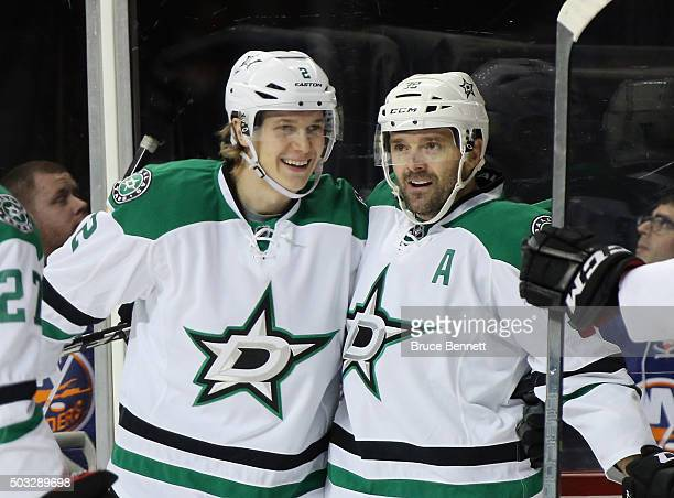 Vernon Fiddler of the Dallas Stars celebrates his goal at 555 of the first period against the New York Islanders and is joined by Jyrki Jokipakka at...