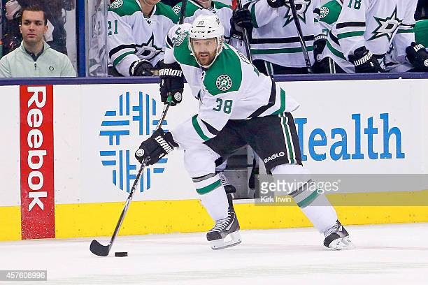 Vernon Fiddler of the Dallas Stars controls the puck during the game against the Columbus Blue Jackets on October 14 2014 at Nationwide Arena in...