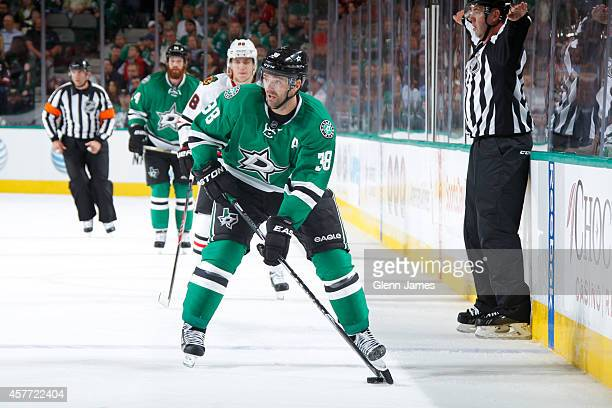Vernon Fiddler of the Dallas Stars handles the puck against the Chicago Blackhawks at the American Airlines Center on October 9 2014 in Dallas Texas