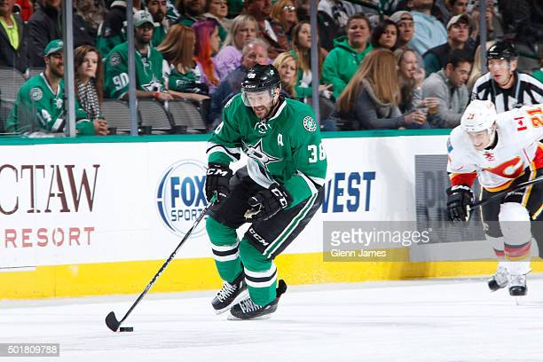 Vernon Fiddler of the Dallas Stars pushes the puck against the Calgary Flames at the American Airlines Center on December 17 2015 in Dallas Texas