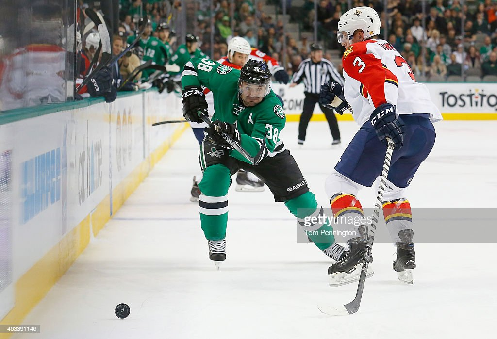 Vernon Fiddler #38 of the Dallas Stars skates for control of the puck against Steven Kampfer #3 of the Florida Panthers in the first period at American Airlines Center on February 13, 2015 in Dallas, Texas.