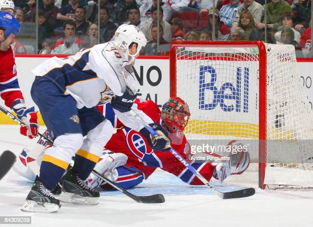 Vernon Fiddler of the Nashville Predators backhands the puck past the glove of Jaroslav Halak of the Montreal Canadiens for a third period goal at...