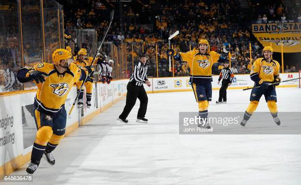 Vernon Fiddler of the Nashville Predators celebrates his goal with James Neal and Roman Josi against the Edmonton Oilers during an NHL game at...